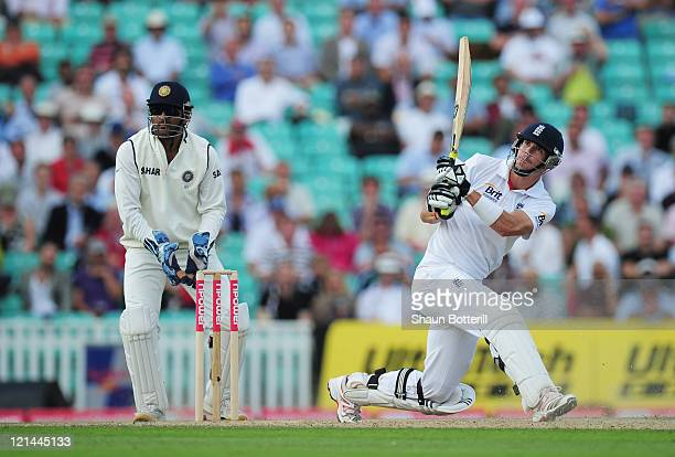 Kevin Pietersen of England switch hits watched by wicketkeeper Mahendra Singh Dhoni of India during day two of the 4th npower Test Match between...