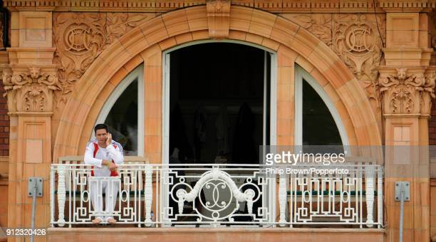 Kevin Pietersen of England talking on the phone while sitting on the dressing room balcony after the 2nd Test match between England and Australia at...