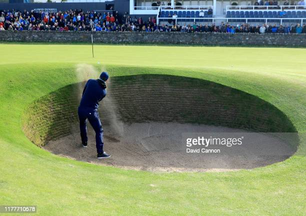 Kevin Pietersen of England the former cricket star plays his third shot on the 17h hole where he had problems with teh 'Road Hole Bunker' during the...