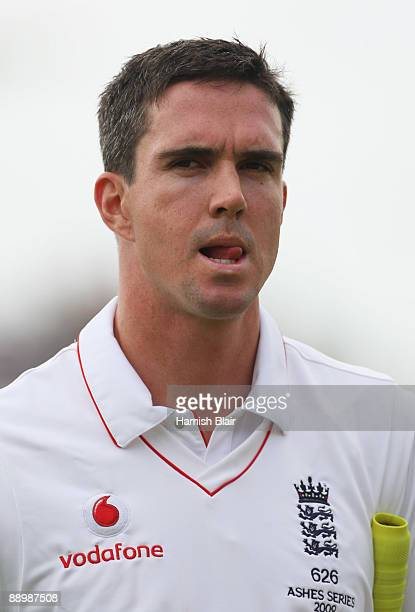 Kevin Pietersen of England walks back after being dismissed by Ben Hilfenhaus of Australia during day five of the npower 1st Ashes Test Match between...