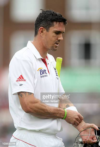 Kevin Pietersen of England walks back after being dismissed by Saeed Ajmal of Pakistan during day three of the npower 3rd Test Match between England...