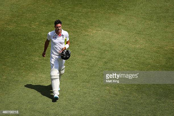 Kevin Pietersen of England walks from the field after being dismissed by Ryan Harris of Australia during day three of the Fifth Ashes Test match...