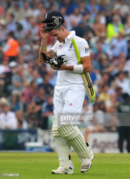 Kevin Pietersen of England walks off after being dismissed by Mitchell Starc of Australia during day three of the 5th Investec Ashes Test match...