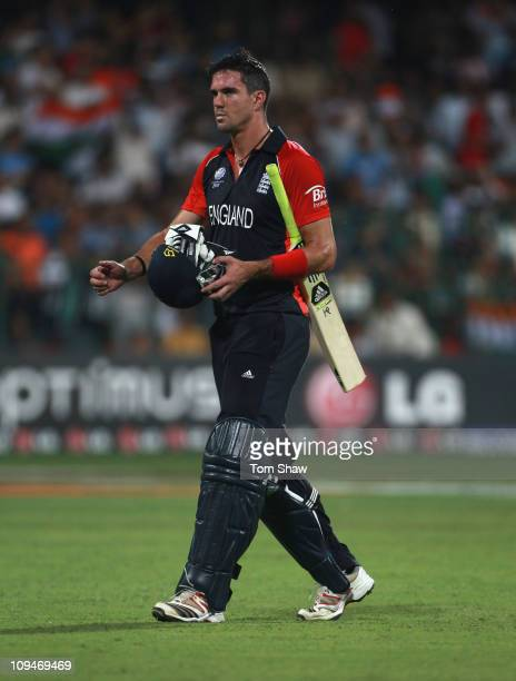 Kevin Pietersen of England walks off after his dismissal during the 2011 ICC World Cup Group B match between India and England at M. Chinnaswamy...