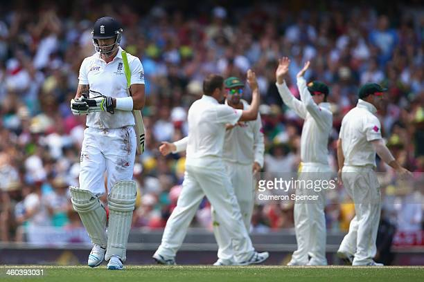 Kevin Pietersen of England walks off the field after being dismissed by Ryan Harris of Australia during day two of the Fifth Ashes Test match between...
