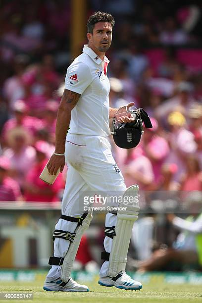 Kevin Pietersen of England walks off the field after being dismissed by Ryan Harris of Australia during day three of the Fifth Ashes Test match...