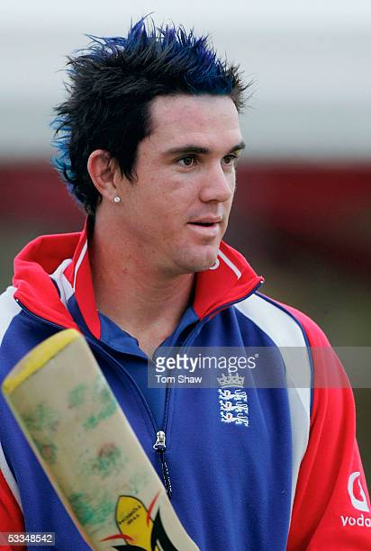 Kevin Pietersen of England with his new blue hair looks on during the team talk during the England nets session prior to the 3rd Ashes Test Match at...