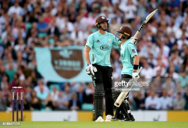 Kevin Pietersen of Surrey celebrates his 50 with Ollie Pope of Surrey during the NatWest T20 Blast match between Surrey and Essex Eagles at The Kia...