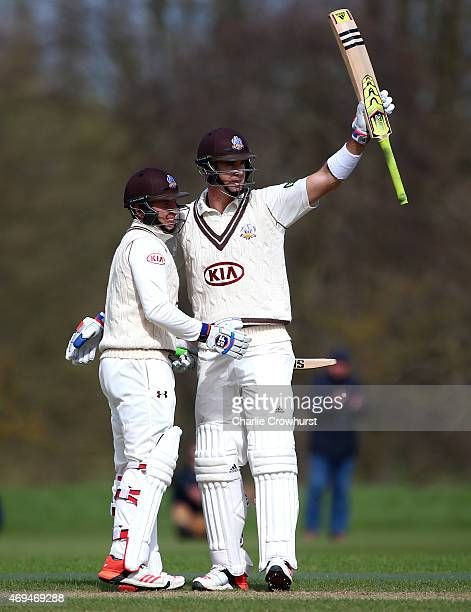 Kevin Pietersen of Surrey celebrates his century with team mate Gary Wilson during day one of the friendly match between Oxford MCCU and Surrey at...