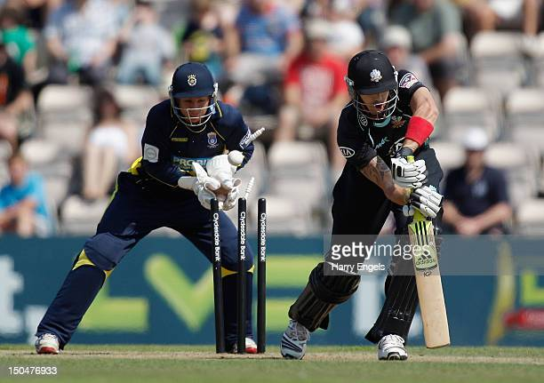 Kevin Pietersen of Surrey is bowled out by Liam Dawson of Hampshire as Hampshire wicketkeeper Michael Bates looks on during the CB40 match between...