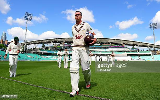 Kevin Pietersen of Surrey leaves the field at the end of the Surrey innings on 355 not out during day three of the LV County Championship match...