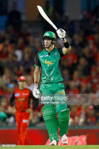 Kevin Pietersen of the Melbourne Stars raises his bat after scoring 50 runs during the Big Bash League match between the Melbourne Renegades and the...