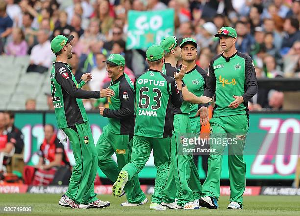 Kevin Pietersen of the Stars celebrates after diving to take a catch to dismiss Sunil Narine of the Renegades during the Big Bash League match...