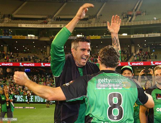 Kevin Pietersen of the Stars celebrates with David Hussey after the Stars defeated the Scorchers in the Big Bash League Semi Final match between the...