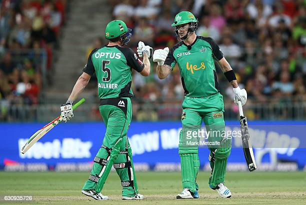 Kevin Pietersen of the Stars celebrates with team mate James Faulkner after scoring a half century during the Big Bash League match between the...