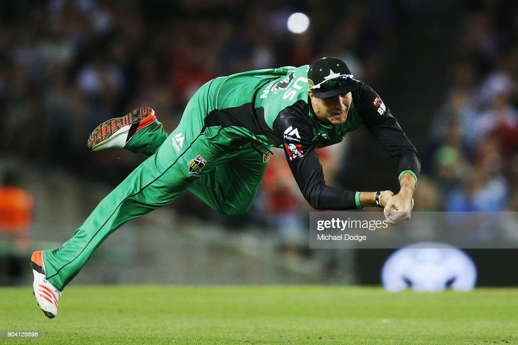 Kevin Pietersen of the Stars takes a diving catch to dismiss Tom Cooper of the Renegades during the Big Bash League match between the Melbourne Renegades and the Melbourne Stars at Etihad Stadium on January 12, 2018 in Melbourne, Australia.