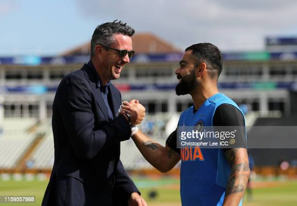 Kevin Pietersen shakes hands with Virat Kohli of India during the Group Stage match of the ICC Cricket World Cup 2019 between Bangladesh and India at...