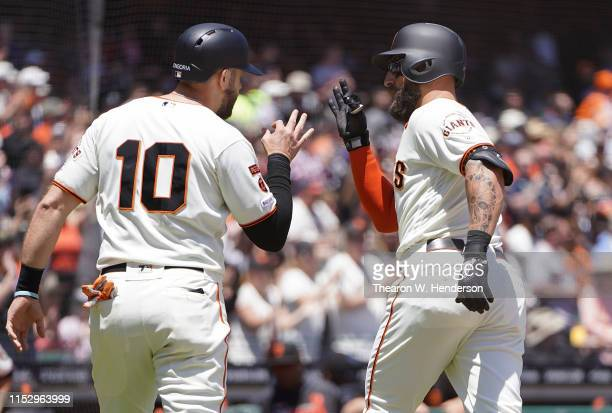 Kevin Pillar and Evan Longoria of the San Francisco Giants celebrate after Pillar hit a tworun home run against the Arizona Diamondbacks in the...