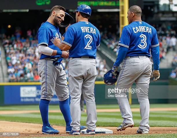 Kevin Pillar and Ezequiel Carrera of the Toronto Blue Jays look at third base coach Luis Rivera after being put out at third on a triple play in the...