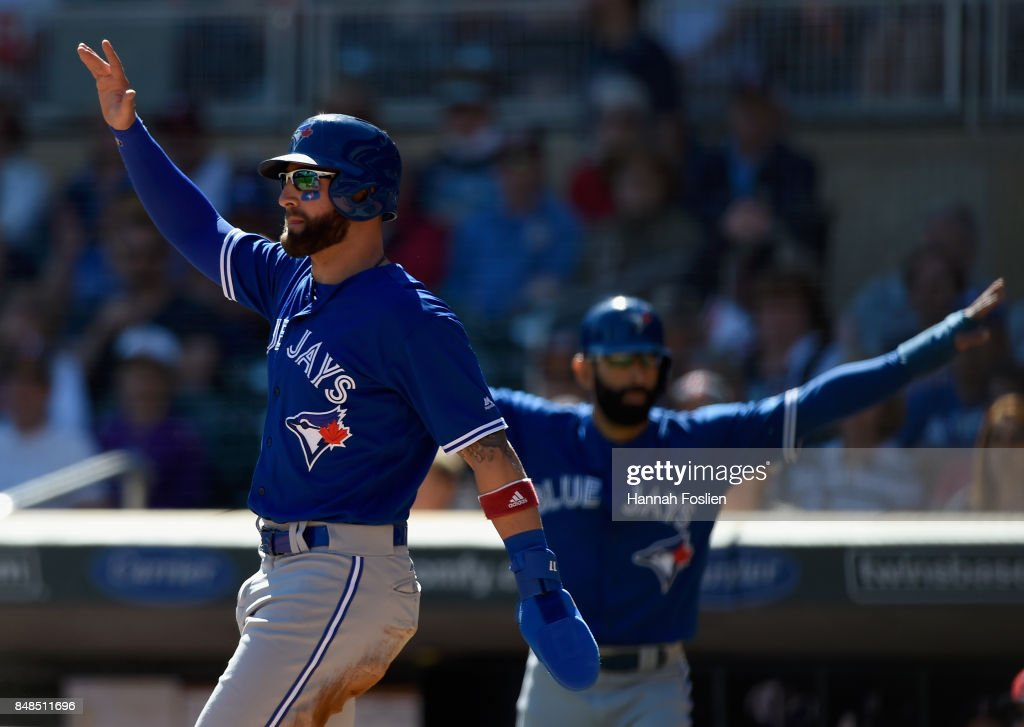 Kevin Pillar #11 and Jose Bautista #19 of the Toronto Blue Jays celebrate after scoring against the Minnesota Twins during the first inning of the game on September 17, 2017 at Target Field in Minneapolis, Minnesota.