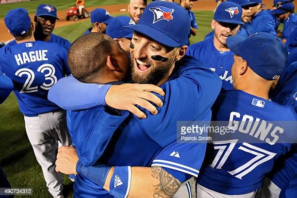 Kevin Pillar and the Toronto Blue Jays celebrate after defeating the Baltimore Orioles and clinching the AL East Division during game one of a double...