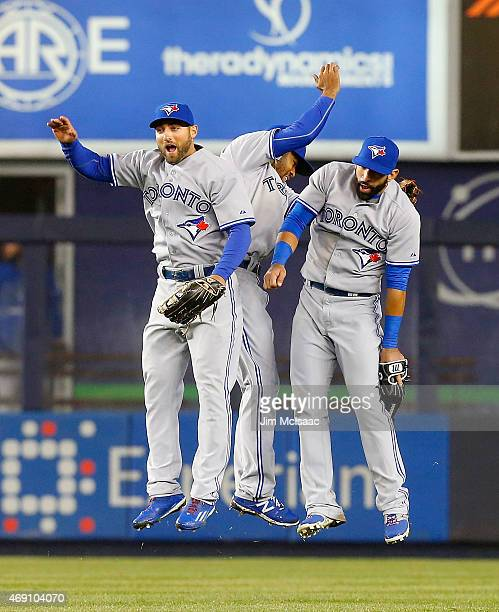 Kevin Pillar, Dalton Pompey and Jose Bautista of the Toronto Blue Jays celebrate after efeating the New York Yankees at Yankee Stadium on April 9,...