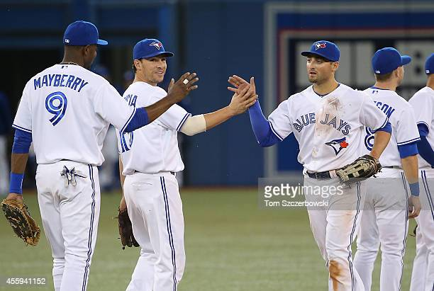 Kevin Pillar Danny Valencia and John Maybery Jr #9 of the Toronto Blue Jays celebrate the win against the Seattle Mariners on September 22 2014 at...
