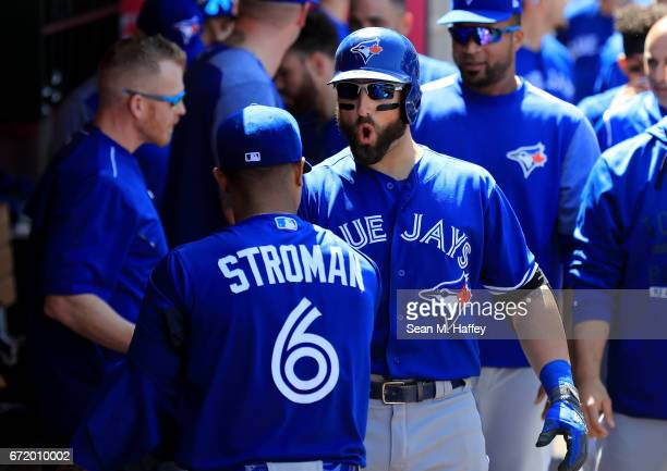 Kevin Pillar is congratulated by Marcus Stroman of the Toronto Blue Jays in the dugout after hitting a solo homerun during the eighth inning of a...