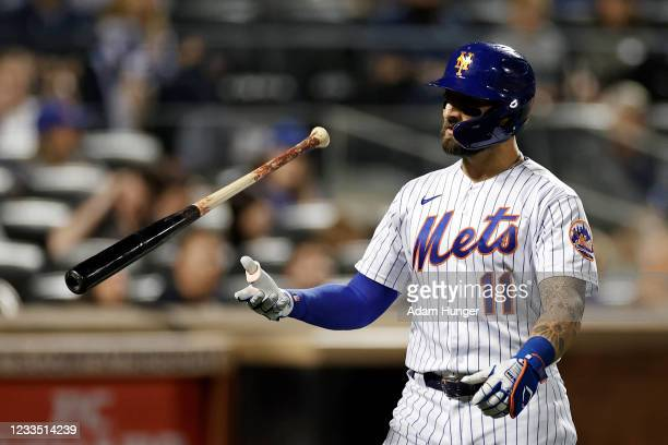 Kevin Pillar of the New York Mets reacts after striking out during the eighth inning against the Chicago Cubs at Citi Field on June 17, 2021 in the...