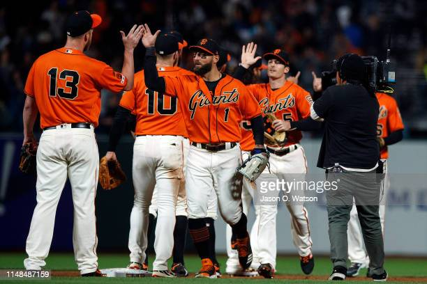 Kevin Pillar of the San Francisco Giants celebrates with Will Smith after the game against the Los Angeles Dodgers at Oracle Park on June 7 2019 in...