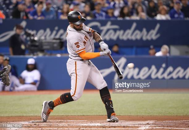 Kevin Pillar of the San Francisco Giants hits an RBI single in the first inning during MLB game action against the Toronto Blue Jays Rogers Centre on...