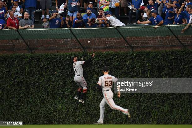 Kevin Pillar of the San Francisco Giants is unable to catch a home run hit by Nicholas Castellanos of the Chicago Cubs during the first inning at...