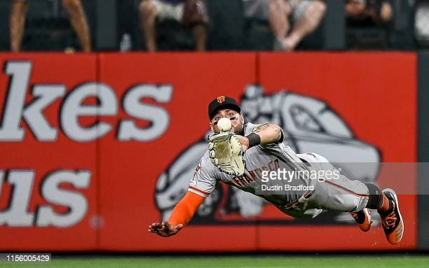 Kevin Pillar of the San Francisco Giants makes a diving catch in center field in the eighth inning against the Colorado Rockies at Coors Field on...