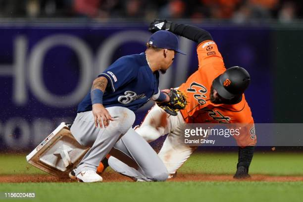 Kevin Pillar of the San Francisco Giants slides safely into second dislodging the base before the tag by Orlando Arcia of the Milwaukee Brewers...