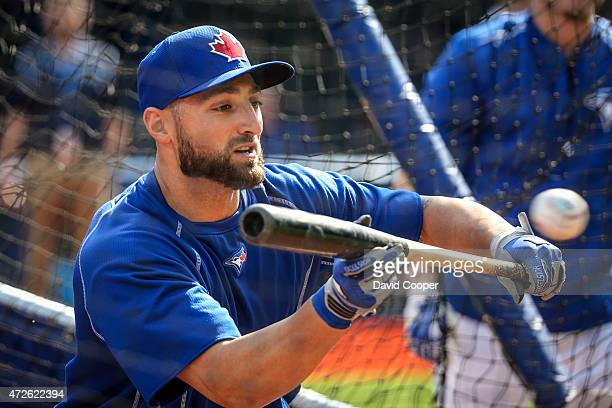 TORONTO ON MAY 8 Kevin Pillar of the Toronto Blue Jays bunts during batting practice before the game between the Toronto Blue Jays and the Boston Red...