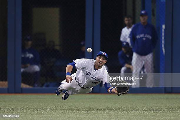 Kevin Pillar of the Toronto Blue Jays cannot get to a double hit in front of him as he dives in the ninth inning during MLB game action against the...