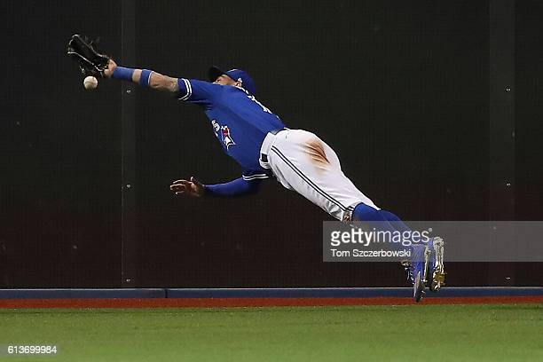 Kevin Pillar of the Toronto Blue Jays cannot reach a two run double hit by Mitch Moreland of the Texas Rangers in the sixth inning during game three...