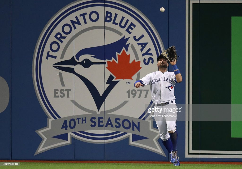 Kevin Pillar #11 of the Toronto Blue Jays catches a fly ball in the ninth inning during MLB game action against the New York Yankees on May 31, 2016 at Rogers Centre in Toronto, Ontario, Canada.