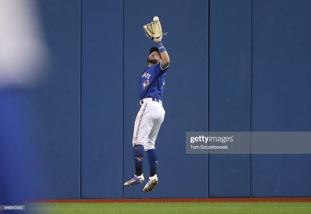 Kevin Pillar #11 of the Toronto Blue Jays catches a line drive in the seventh inning during MLB game action against the Kansas City Royals at Rogers Centre on April 18, 2018 in Toronto, Canada.
