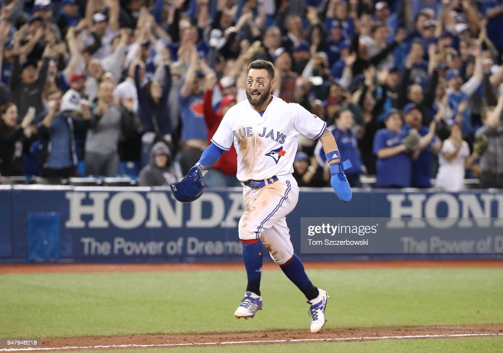 Kevin Pillar #11 of the Toronto Blue Jays celebrates a game-winning RBI single by Luke Maile #21 as he comes to score the winning run in the tenth inning during MLB game action against the Kansas City Royals at Rogers Centre on April 17, 2018 in Toronto, Canada.