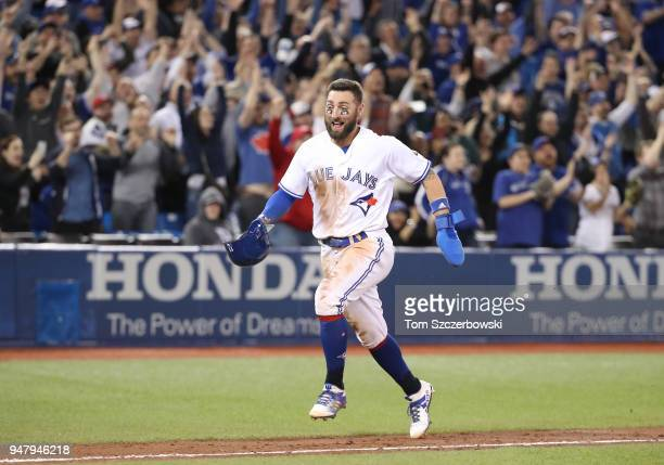 Kevin Pillar of the Toronto Blue Jays celebrates a gamewinning RBI single by Luke Maile as he comes to score the winning run in the tenth inning...