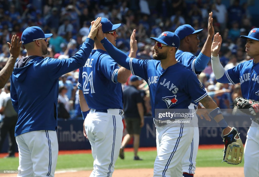 Kevin Pillar #11 of the Toronto Blue Jays celebrates a victory with teammates against the Atlanta Braves at Rogers Centre on June 20, 2018 in Toronto, Canada.