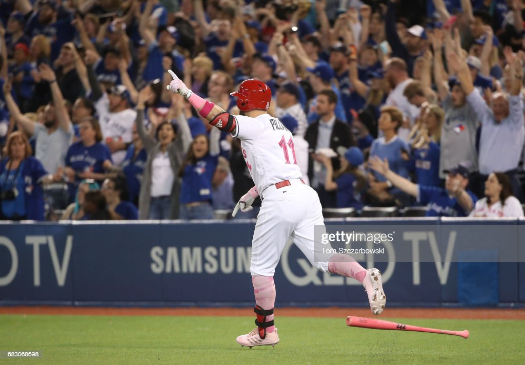 Kevin Pillar #11 of the Toronto Blue Jays celebrates as he hits a game-winning solo home run in the ninth inning during MLB game action against the Seattle Mariners at Rogers Centre on May 14, 2017 in Toronto, Canada.