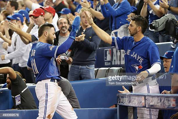 Kevin Pillar of the Toronto Blue Jays celebrates with Chris Colabello of the Toronto Blue Jays after scoring a run in the second inning against the...