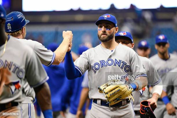 Kevin Pillar of the Toronto Blue Jays celebrates with teammates after winning 21 against the Tampa Bay Rays on May 6 2018 at Tropicana Field in St...