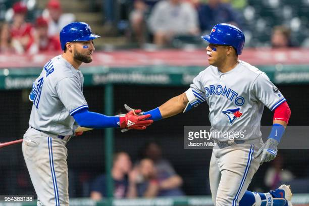 Kevin Pillar of the Toronto Blue Jays celebrates with Yangervis Solarte after Solarte's solo home run in the second inning against the Cleveland...