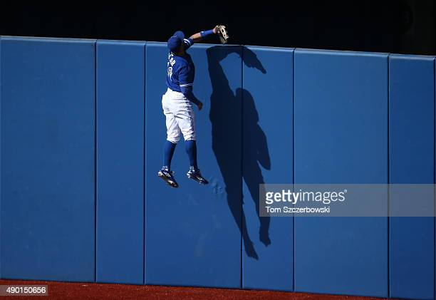 Kevin Pillar of the Toronto Blue Jays climbs the wall but cannot get to a solo home run hit by Kevin Kiermaier of the Tampa Bay Rays in the fourth...
