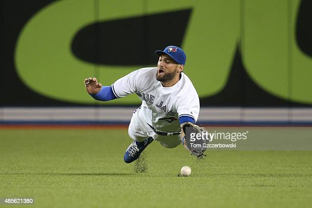 Kevin Pillar of the Toronto Blue Jays dives but cannot catch a single hit by Ian Kinsler of the Detroit Tigers in the sixth inning during MLB game...