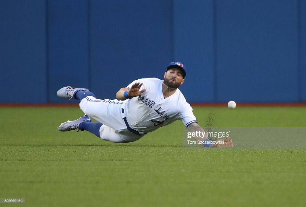 Kevin Pillar #11 of the Toronto Blue Jays dives but cannot get to a ball off the bat of George Springer of the Houston Astros that went for a single in the fifth inning during MLB game action at Rogers Centre on July 6, 2017 in Toronto, Canada.