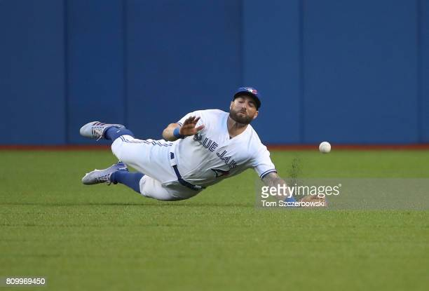 Kevin Pillar of the Toronto Blue Jays dives but cannot get to a ball off the bat of George Springer of the Houston Astros that went for a single in...